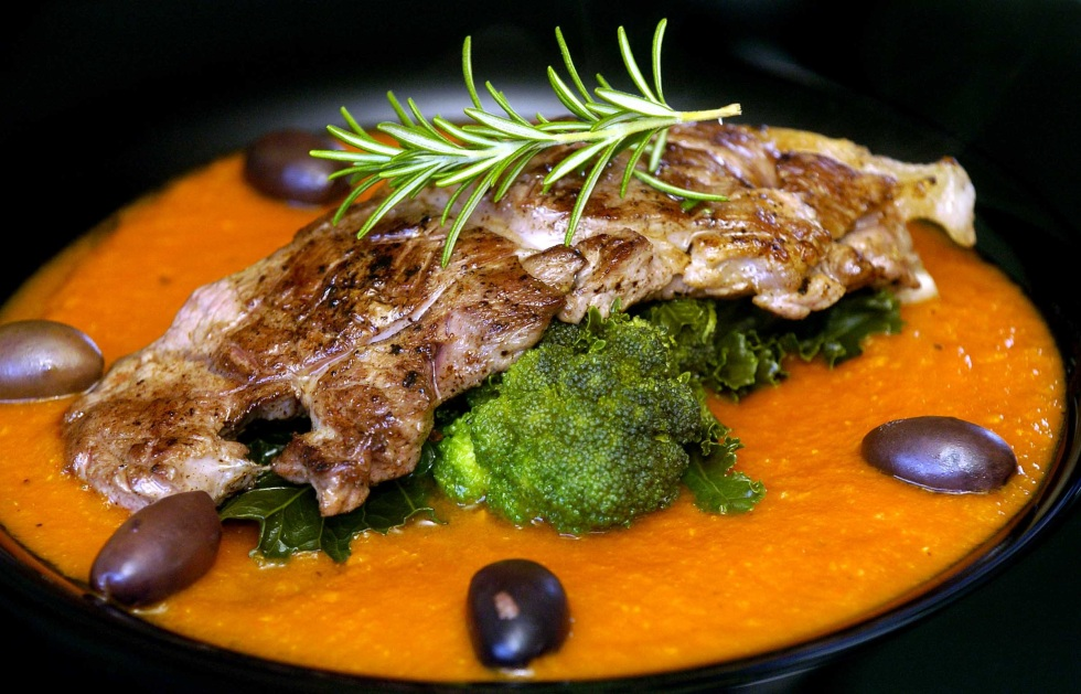 KEVIN ASHTON 01...KEVIN ASHTON 01. Italian Chargrilled Lamb Steak, with green vegetables on a tomato sauce and olives. PIC FOR SUNDAY MERCURY.
